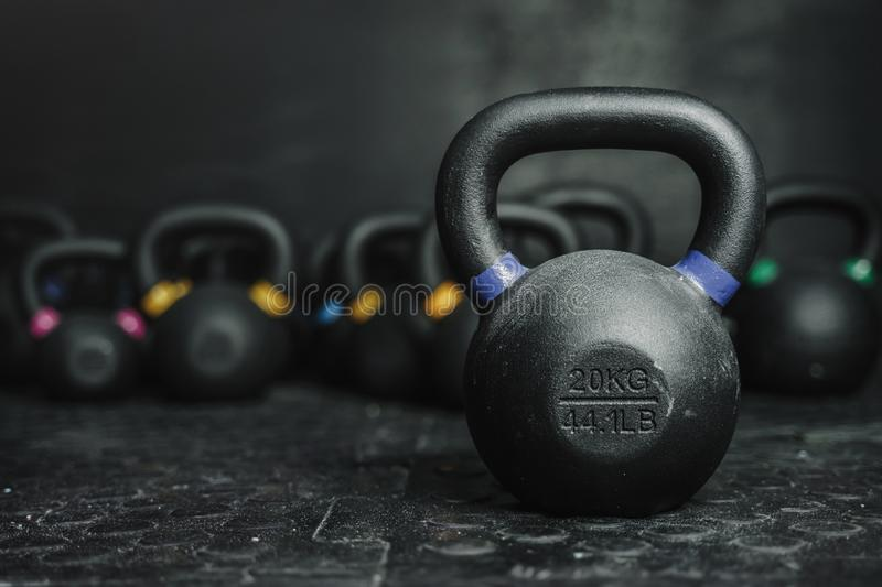 Kettlebells on dark backgroud at the crossfit gym. Kettlebell equipment on dark backgroud at the crossfit gym. Sport concept. Copy space royalty free stock images
