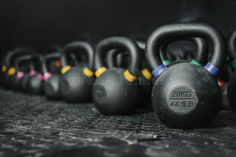 Kettlebells on dark backgroud at the crossfit gym. Kettlebells at the crossfit gym. Sport concept. Copy space stock photography
