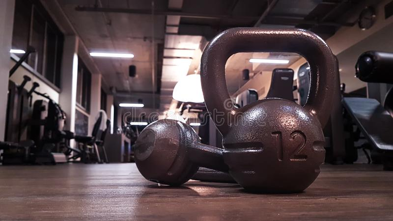 Kettlebells in gym on the floor. With blurred background stock photography