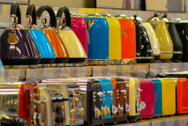 Kettles & Toasters. A row of colourful kettles & toasters for sale in a store royalty free stock images