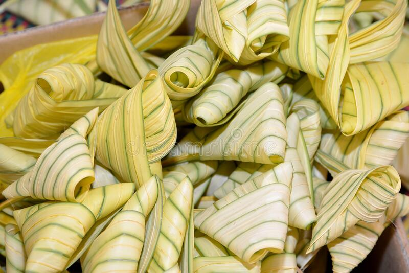 Ketupat. Kupat or Tipat is a type of dumpling made from rice packed inside a diamond-shaped container of woven palm leaf pouch, originating in Indonesia. It is stock photography