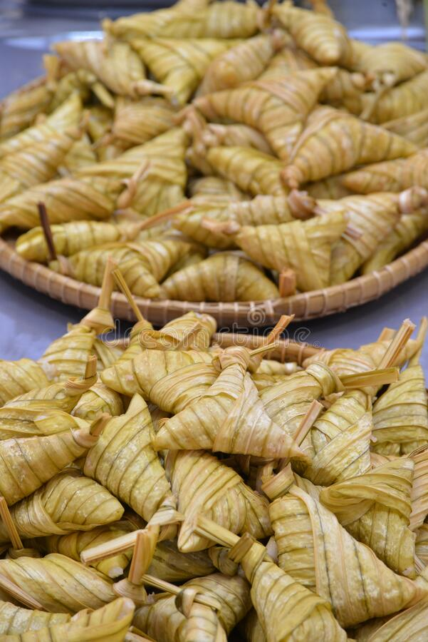 Ketupat. Kupat or Tipat is a type of dumpling made from rice packed inside a diamond-shaped container of woven palm leaf pouch, originating in Indonesia. It is stock photo