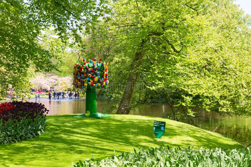 Keukenhof, Netherlands - May, 2018: Wooden tree decoration near the river bank in Keukenhof park in Amsterdam area, Netherlands. royalty free stock photography