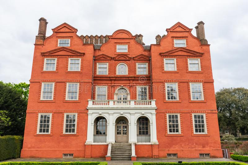 Kew Palace is a British royal palace in Kew Gardens on the banks of the Thames up river from London royalty free stock photo