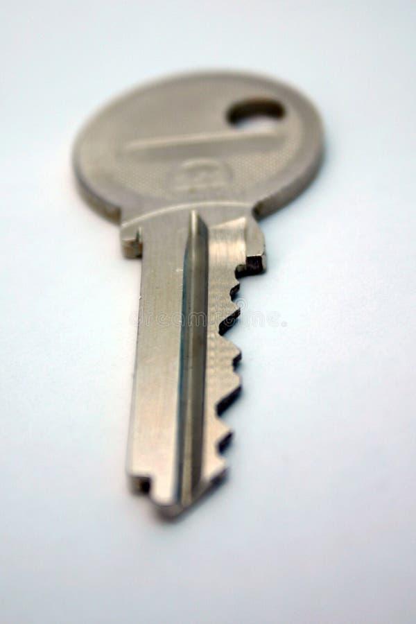 Key. A key on a white background stock photos
