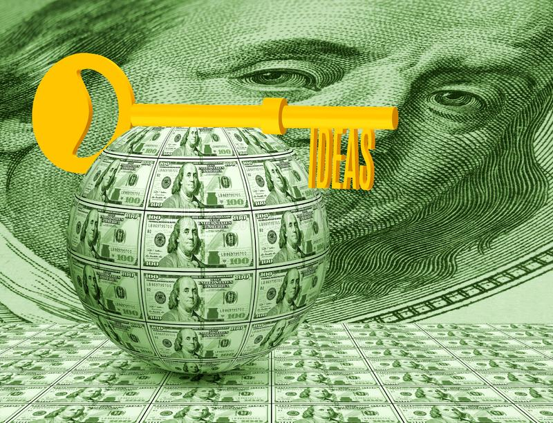 Key on the ball of money close-up. Symbolizes business, money, idea. Image of the key on the ball of money close-up. Symbolizes business, money, idea stock image