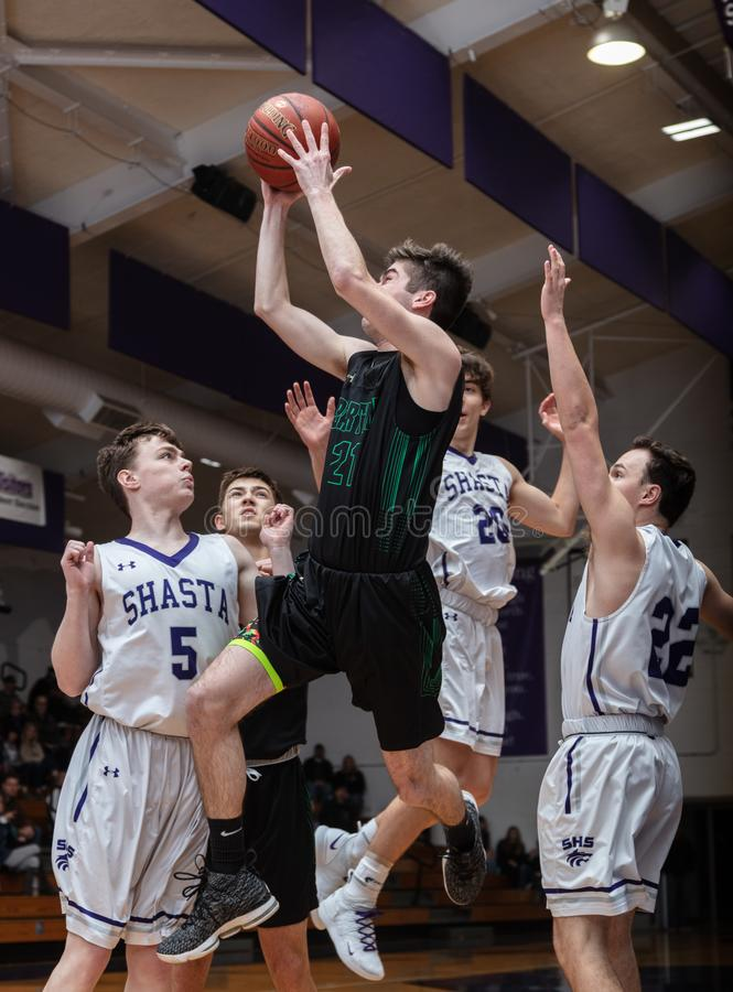 In the Key. Basketball action with Red Bluff vs. Shasta High School in Redding, California royalty free stock image