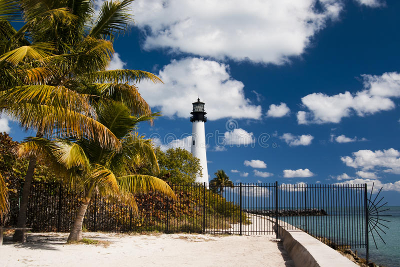 Key Biscayne Lighthouse. View of Key Biscayne lighthouse from the beach with palm trees in a sunny day with clouds - Miami (USA - 2010 stock photography