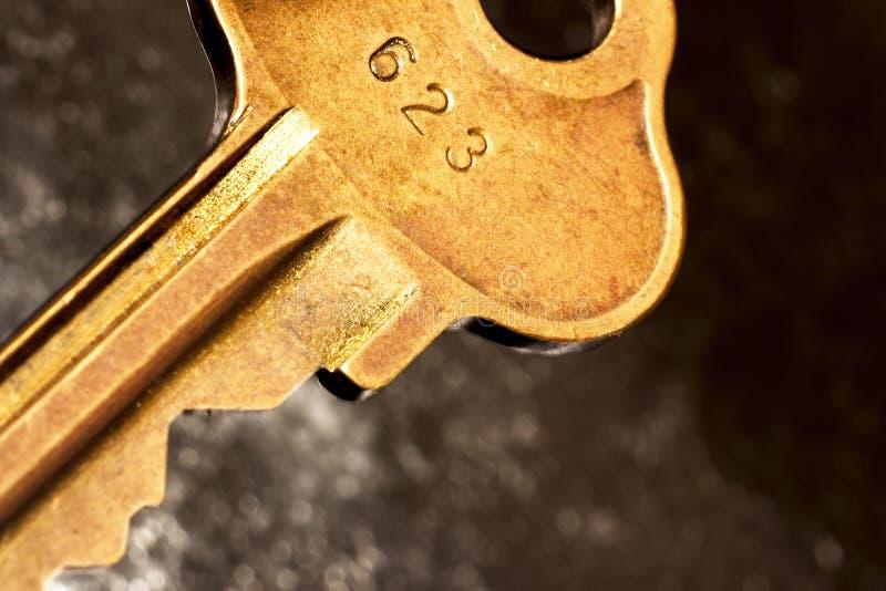 Key closeup. Macro shot of old brass key royalty free stock photography
