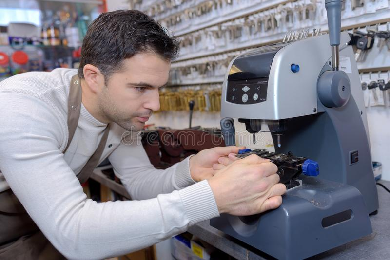 Key cutter using machine. Key stock image