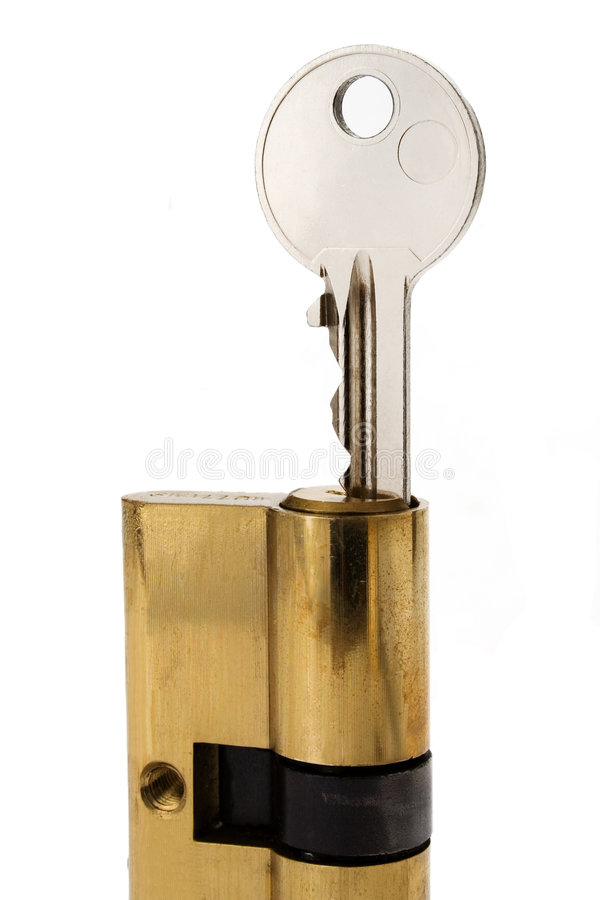 """Key_in_cylinder_lock. A key half entered in a cylinder lock, ready to open your """"closed doors stock photo"""
