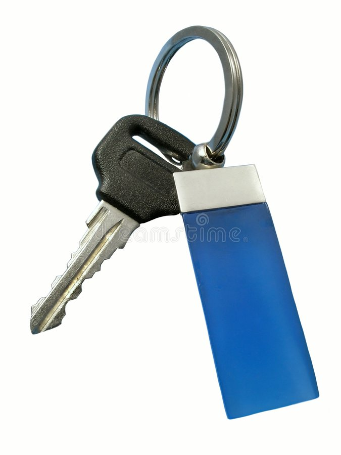 Key with decoration. Automobile key with decoration. Isolated royalty free stock photo