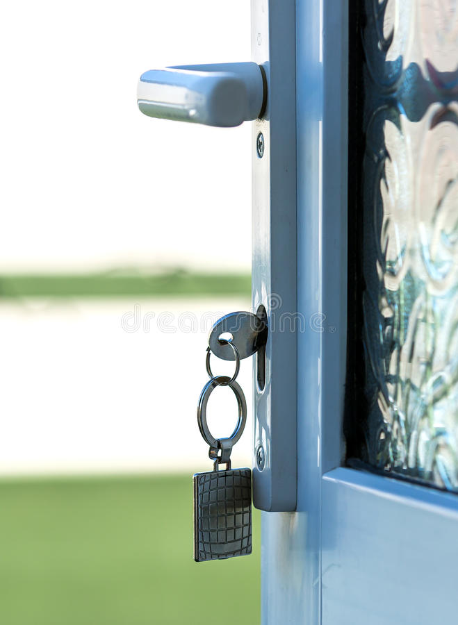 Key in Door Lock stock photography