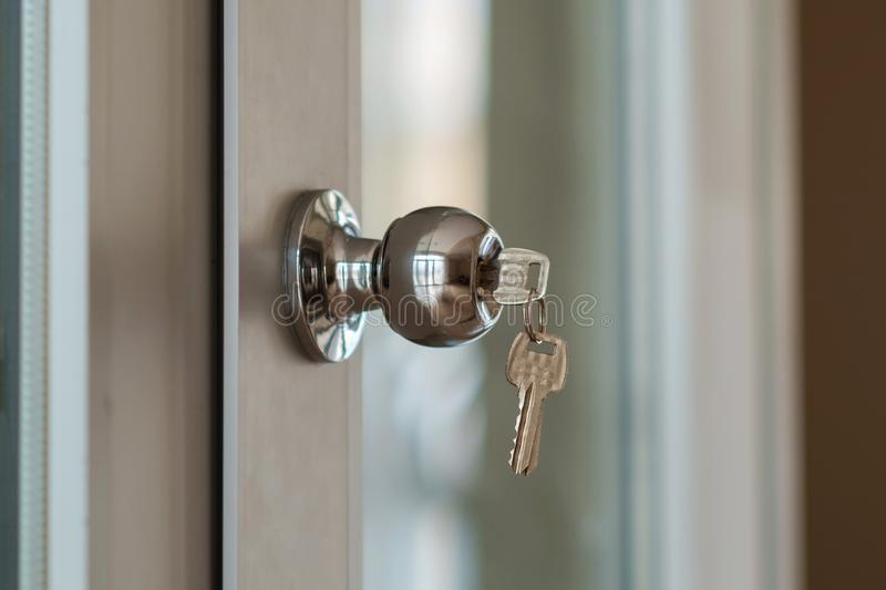 Key in door lock stock photos