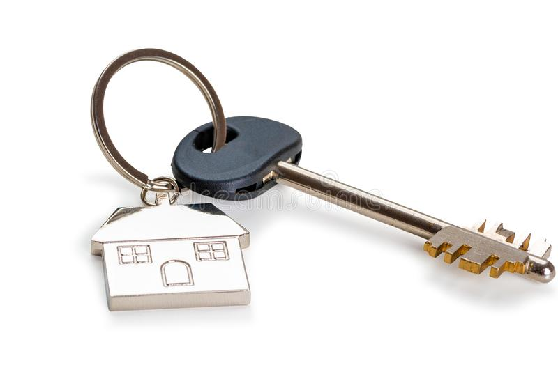 Key with a key fob in the form of a house on a white background. Is isolated stock photography