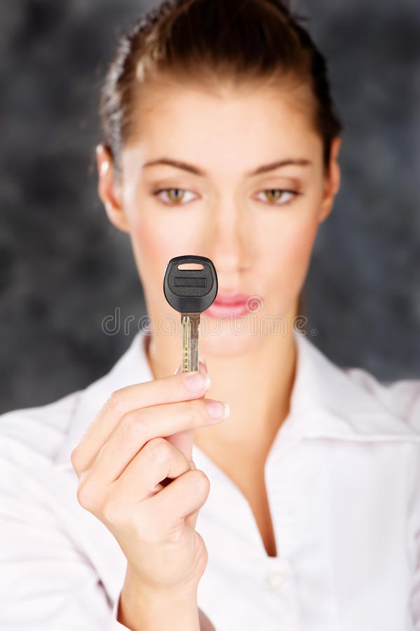 Key in a hand of a woman royalty free stock photos