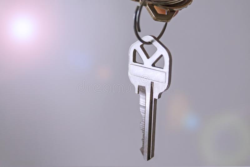 key hanging with abstract background. Silver key hanging close-up with abstract background stock photo
