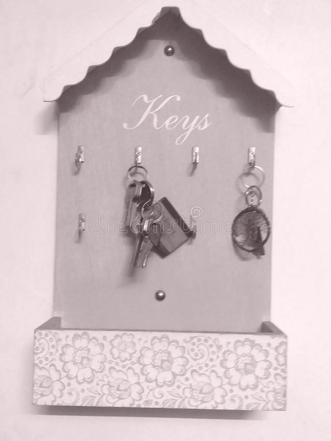 Key holder on the wall with key rings. Key rack or holder on the wall with key rings royalty free stock photography