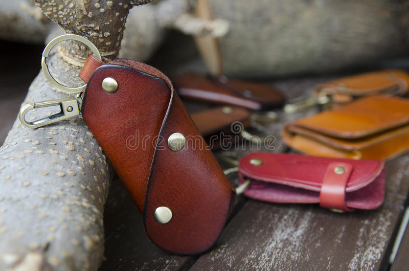 Key holders. Assorted key holders on rough wood background stock images