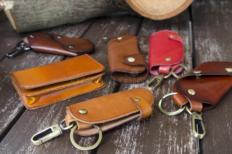 Key holders. Assorted key holders on rough wood background stock photo
