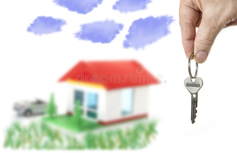 Key from the house in the hand on the white. Key from the house in the hand on the white stock photos