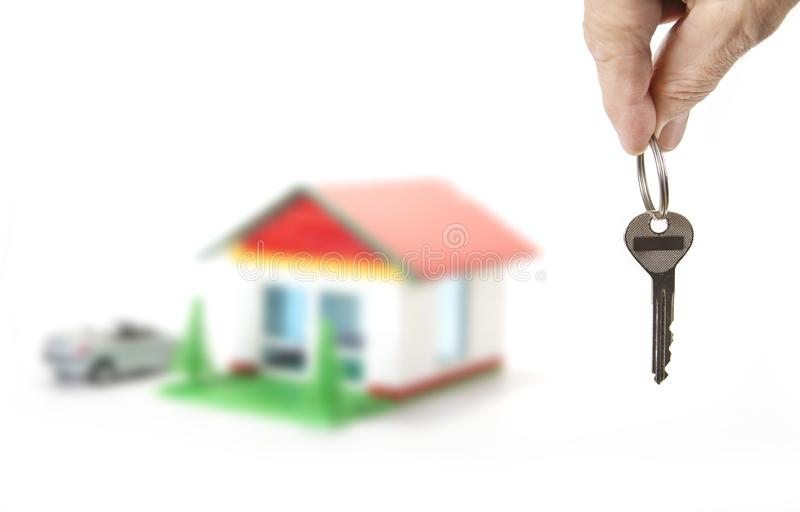 Key from the house in the hand on the white. Key from the house in the hand on the white royalty free stock images