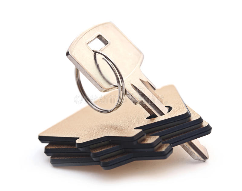 Key with house-shaped charm royalty free stock photos