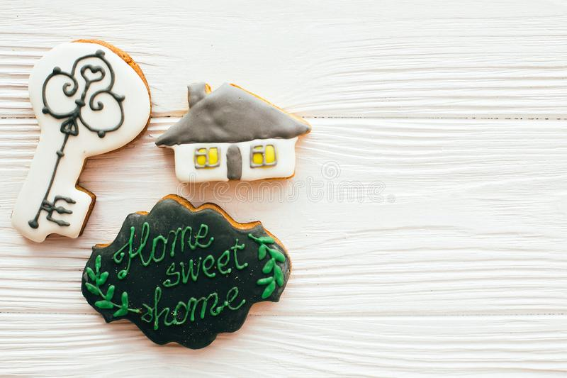 Key, house, welcome sign cookies on white wood, flat lay with space for text. Dream home concept. Home Sweet Home. Moving in new. House, Welcome home set stock image