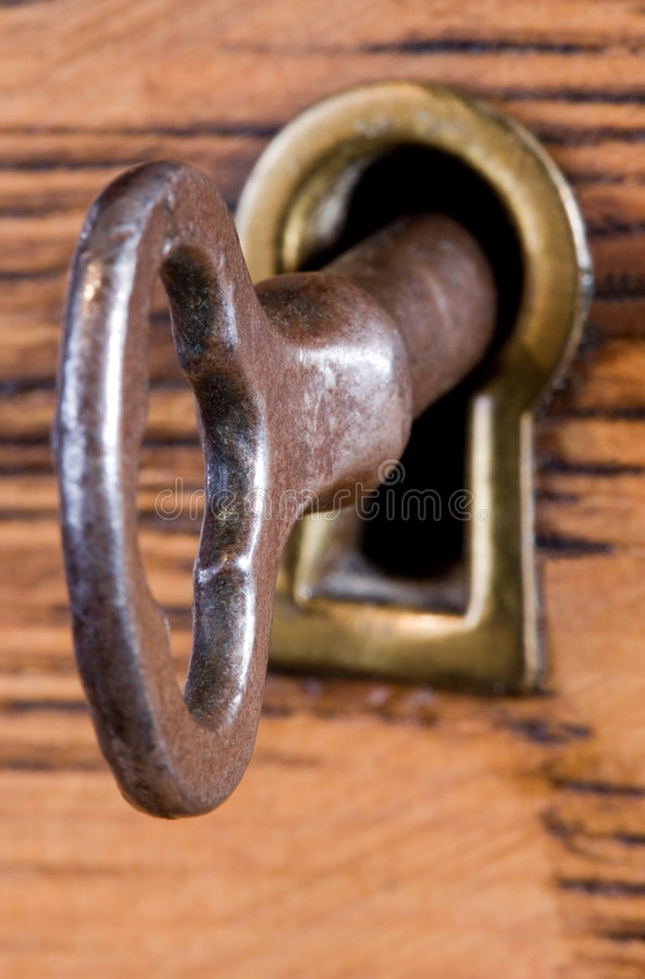 Key in Keyhole royalty free stock images