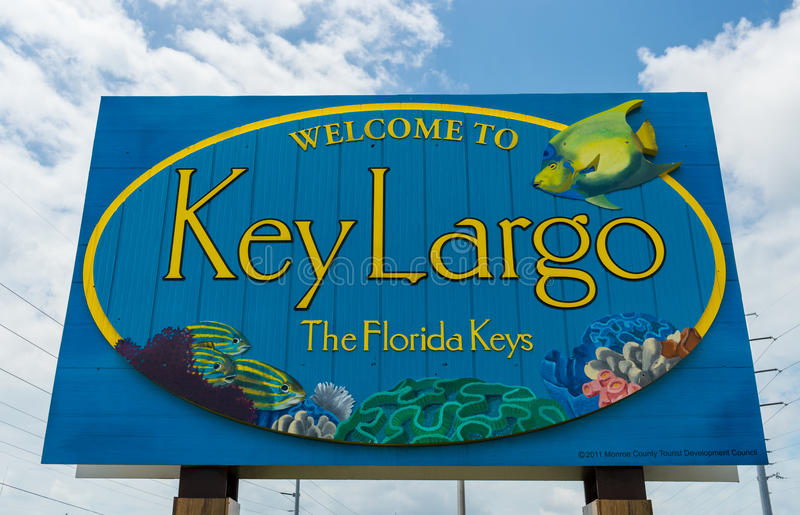 Key Largo welcome sign. KEY LARGO, FL - CIRCA 2012: Welcome sign over the US1 in Key Largo circa 2012. The Florida Keys are a very popular tourist destination royalty free stock image