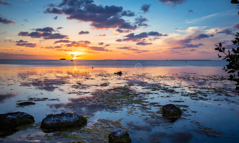 Key Largo sunset with clouds, boat and water royalty free stock photography