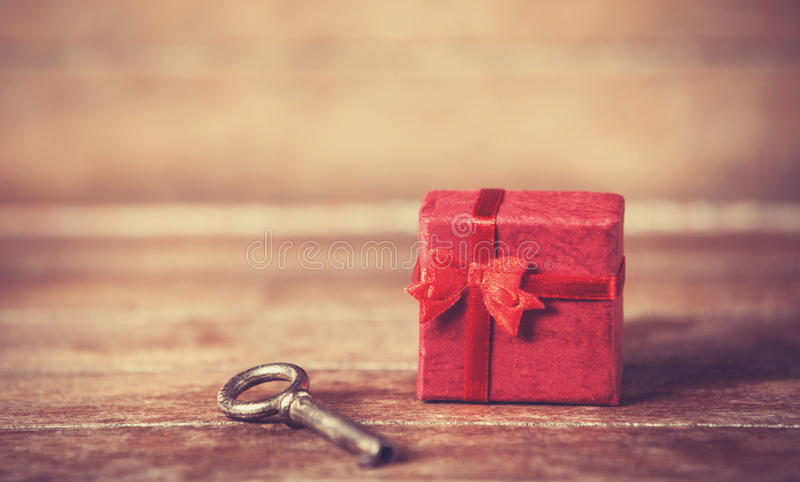 Key and little gift stock image
