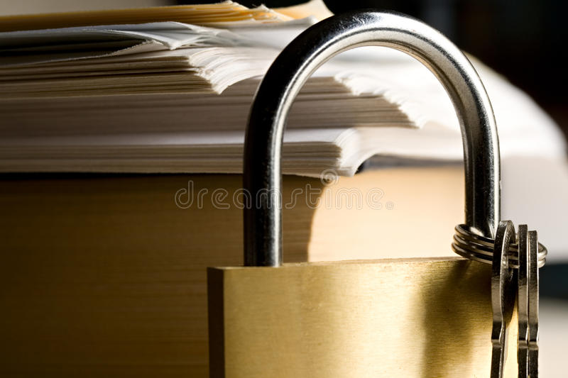 Key lock and a book. Key lock against the background of paper royalty free stock photography