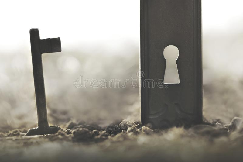 Key and lock; conceptual photo of solution and problem solving. Key and lock; a conceptual photo of solution and problem solving royalty free stock images
