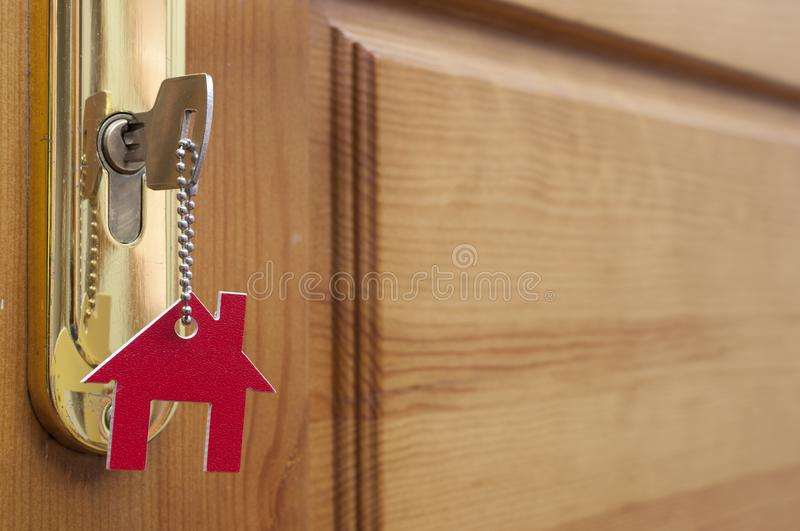 A key in a lock with house icon on it royalty free stock image