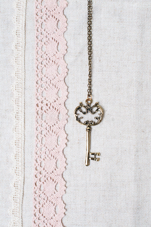 Key, natural linen fabric and lace