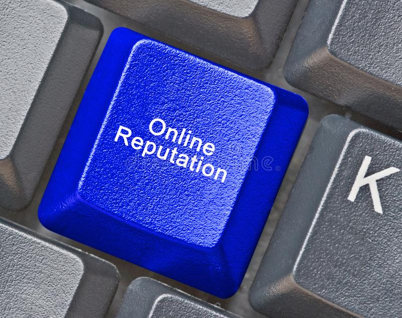 Key for online reputation. Blue key for online reputation stock photography