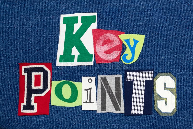 KEY POINTS text word collage colorful fabric on denim, presentation summary stock photography