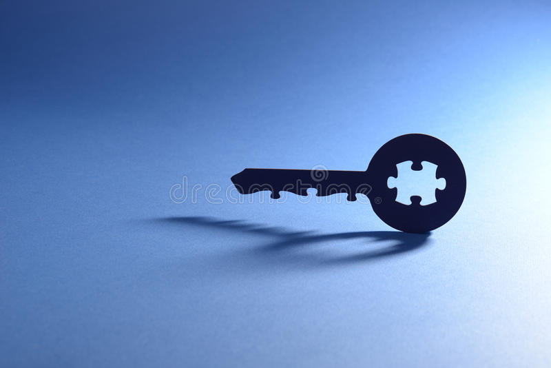 Key with puzzle code. Cut out key with puzzle code stock photos