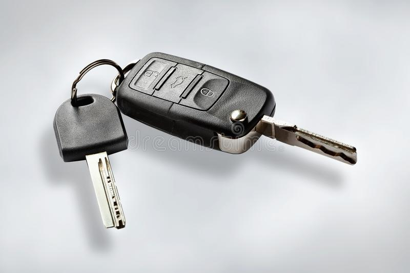 Key with remote control. Key to the wireless transmission on white background stock photos