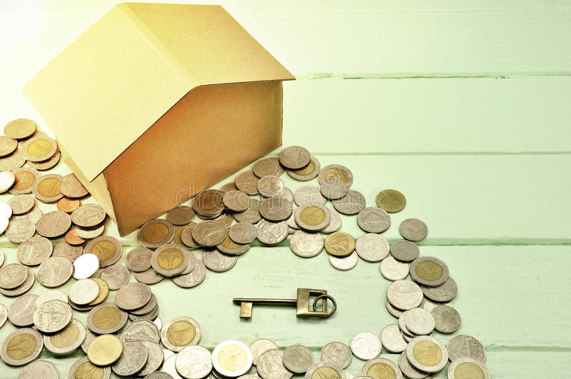 Key Saving money concept preset by money coin growing business.Tag save, saving pile of coins. Saving money for buying a house, H. Home concept and focus golden stock images