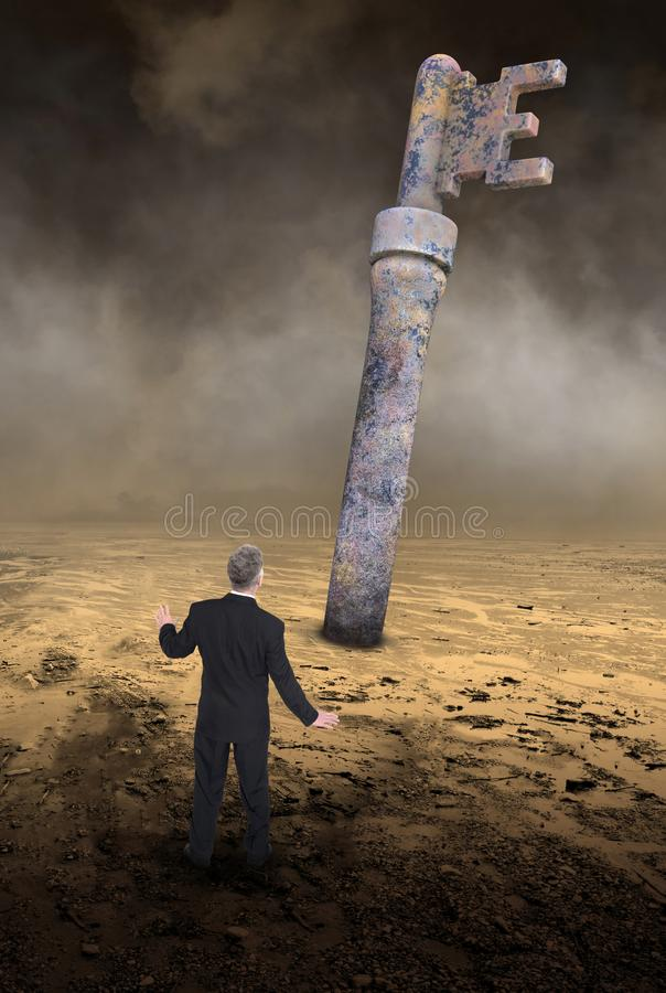 Key, Success, Goals, Business, Marketing, Sales. Surreal abstract concept of a businessman standing in a desolate desert with the key to success. Metaphor for royalty free stock images