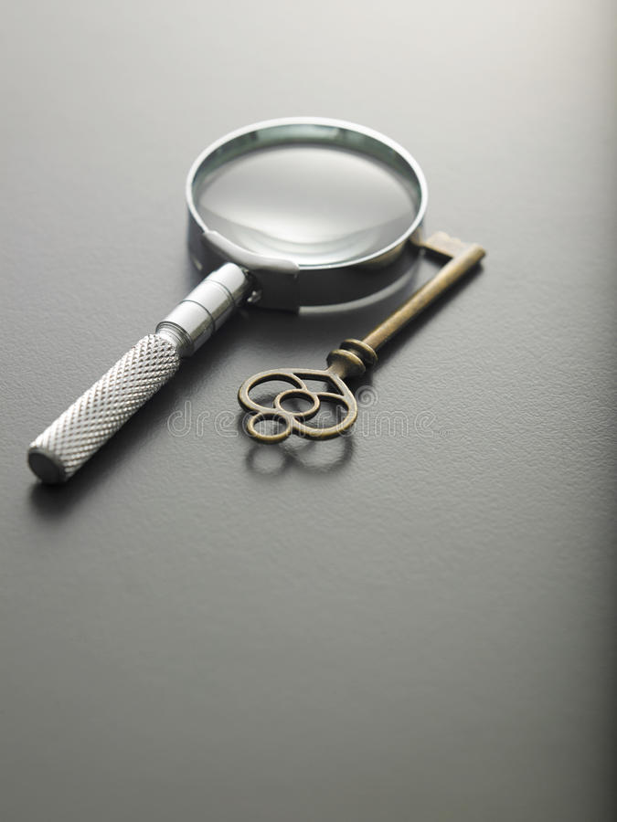 Key of success. Magnifying glass and a key royalty free stock photo