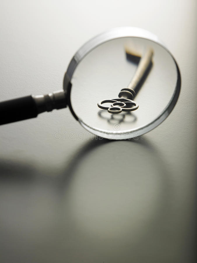 Key of success. Magnifying glass on a key stock photo