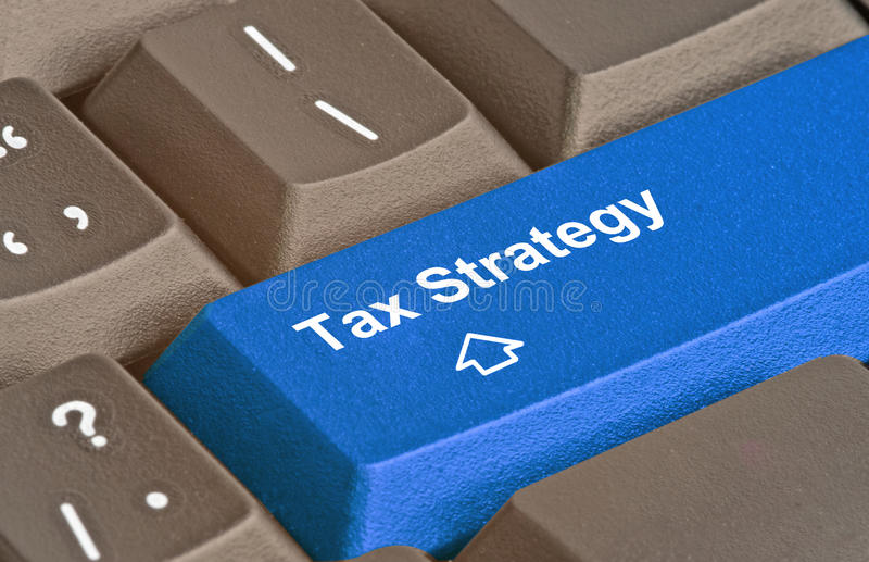 Key for tax planning. Blue key for tax planning stock images