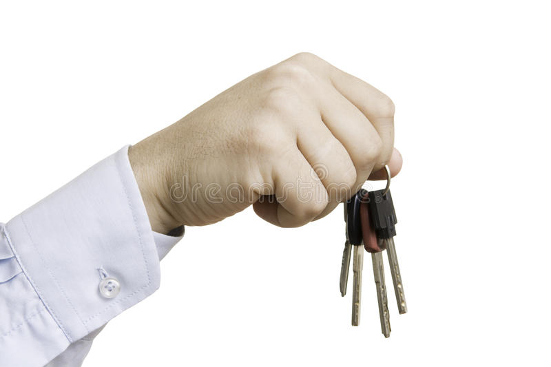 The key to the car. In hand on white background stock photo