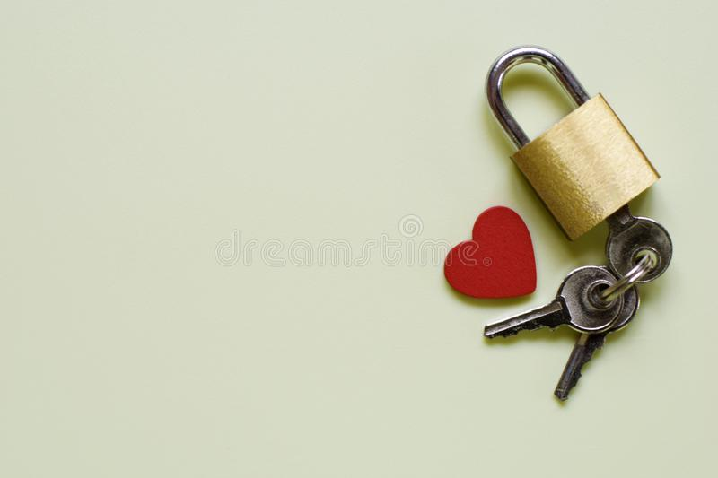 Composition with lock, key and heart on very light green background royalty free stock photo