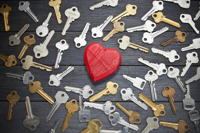 Key Love Heart Search Romance. A conceptual image with a heart and keys on a wood background