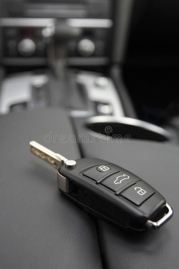 Key to a luxury car. Car key to a German luxury car, the key is lying on dark leather royalty free stock photo