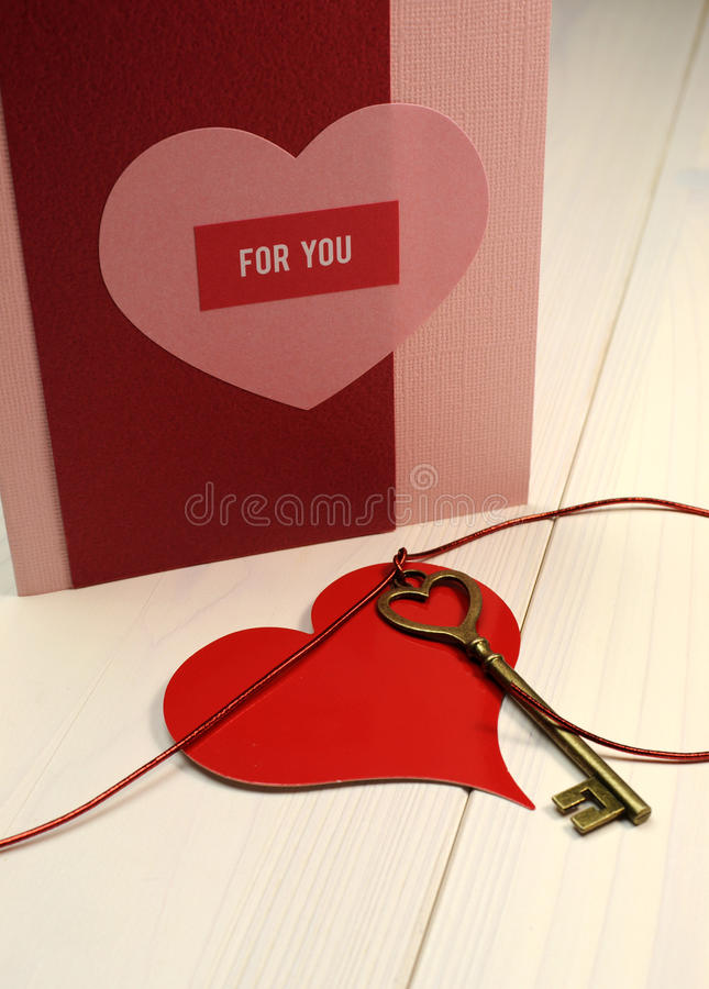 'Key to My Heart' love concept, with gold heart shape key and red heart gift tag. 'Key to My Heart' love concept, with gold heart shape key and red heart on royalty free stock photo